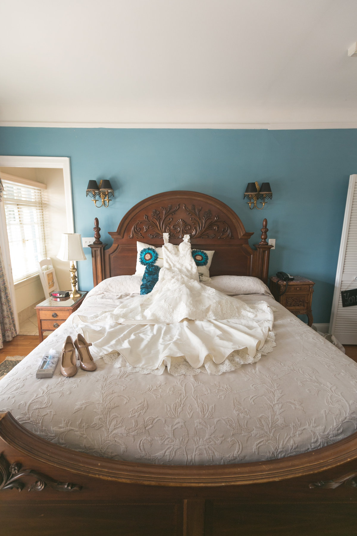 Dress and details on a bed at Club Continental Orange park