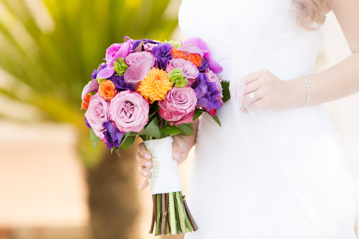 Bride holds her brightly colored bouquet for her portraits at villa de amore by matty fran photography
