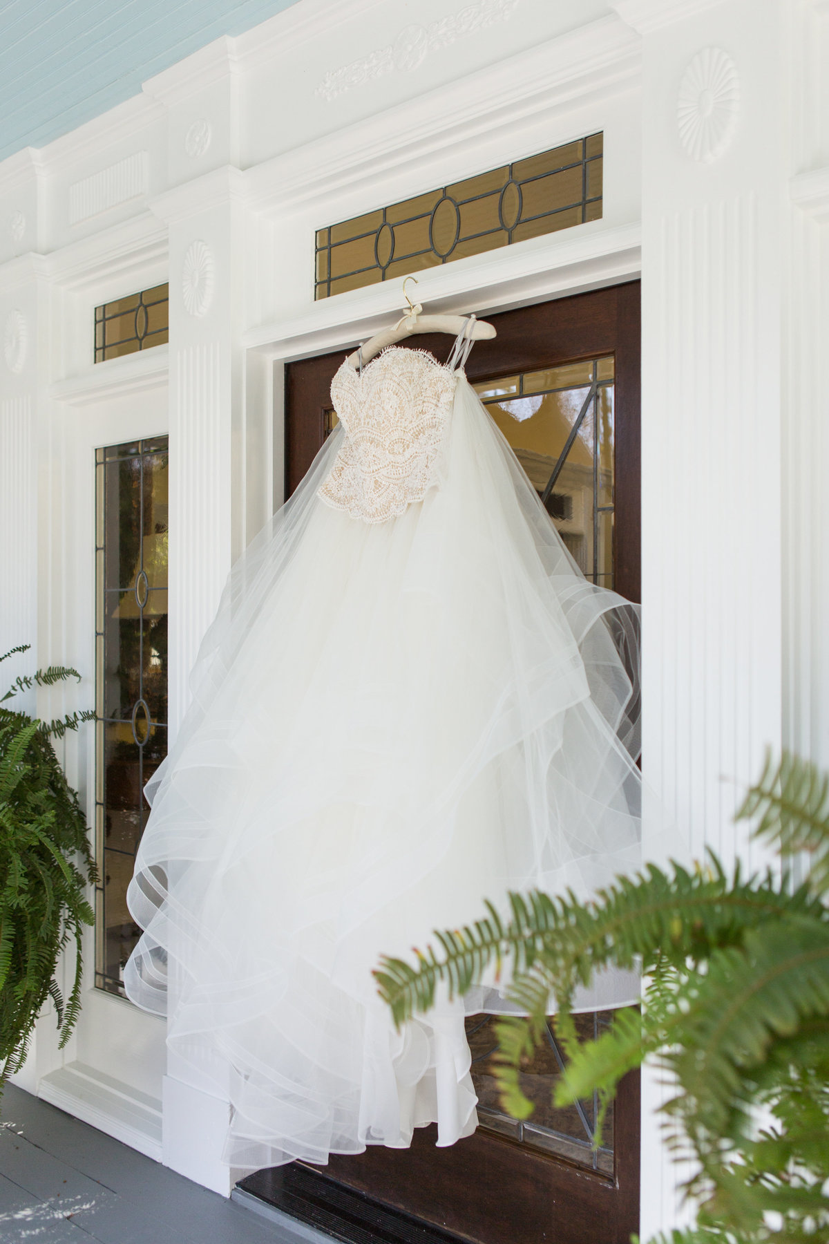wedding dress hanging on door of mackey house