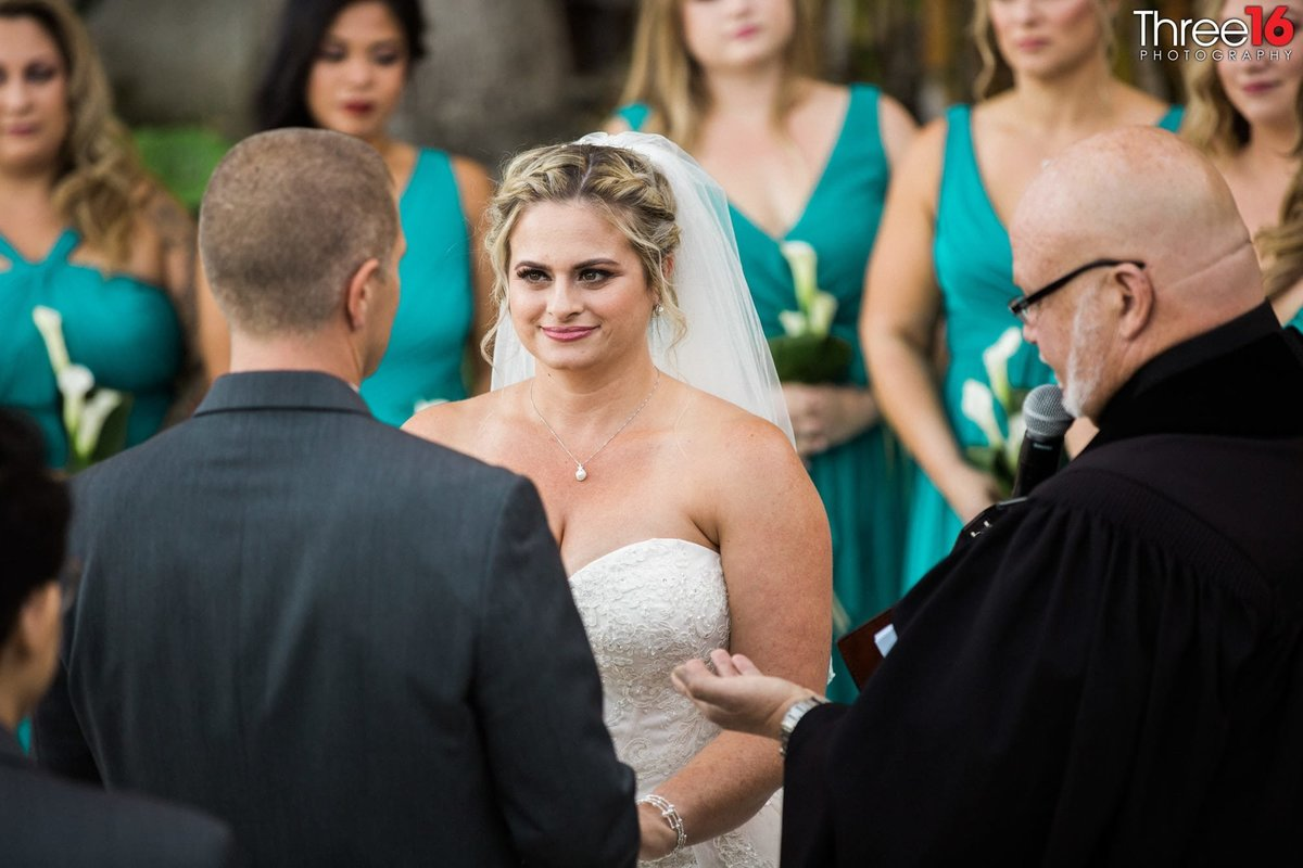 Bride and Groom stare at each other during their wedding vows