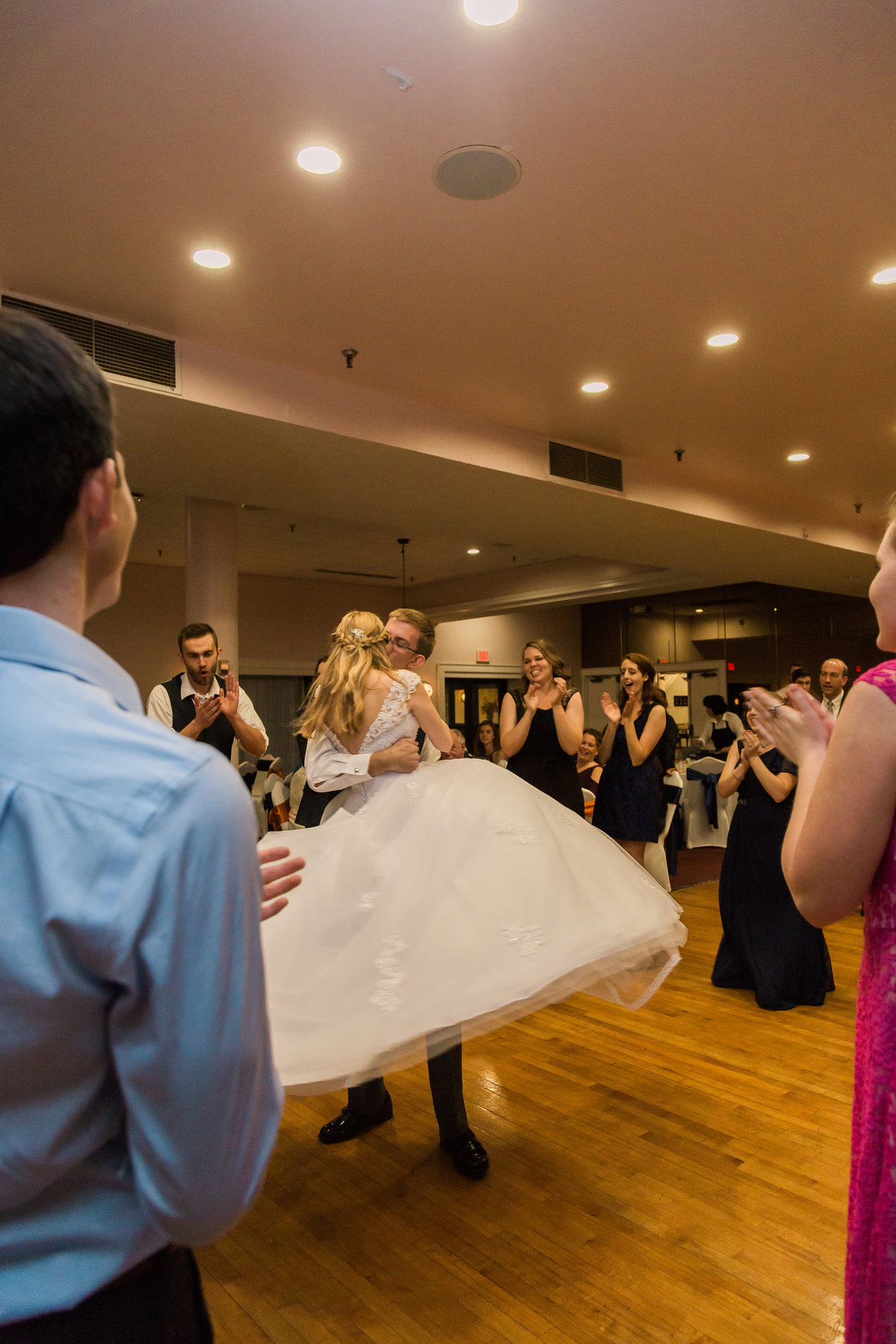 A bride and groom dance at Fort Eustis