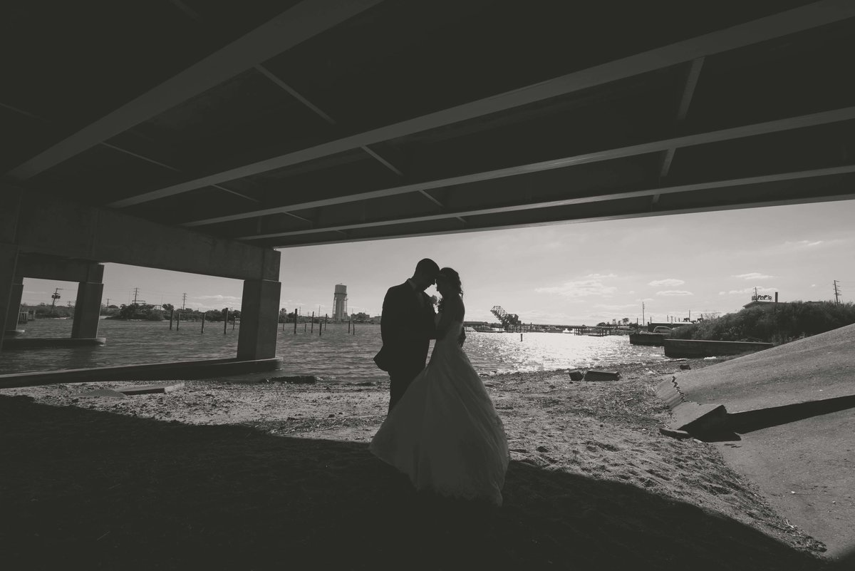 Black and white photo of a bride and groom at Bridgeview Yacht Club