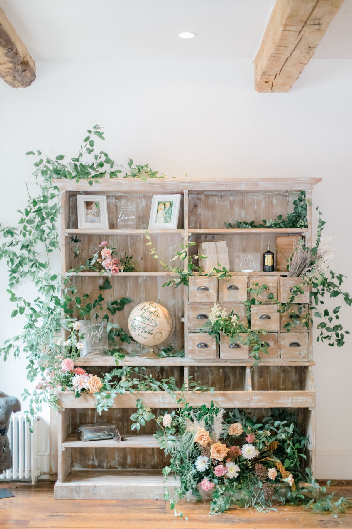 floral covered bookcase at private estate wedding in charlottesville virginia by costola photography