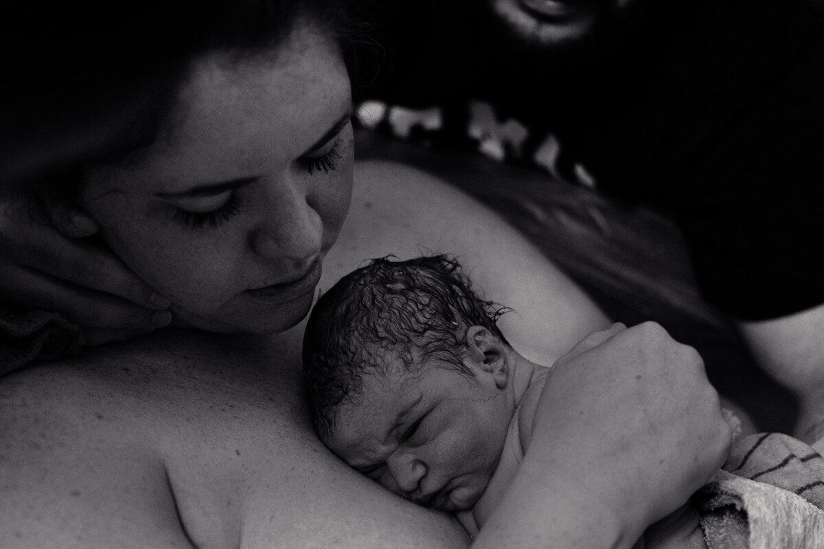 mother holding newborn after home birth