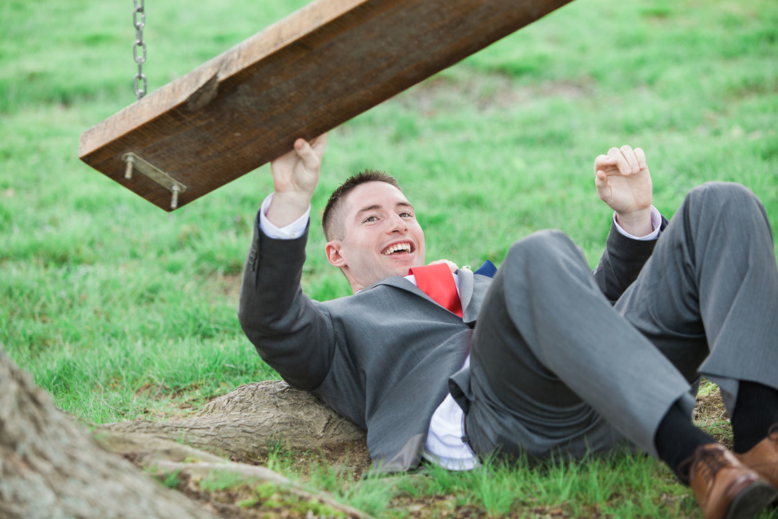 Groom falling off of swing