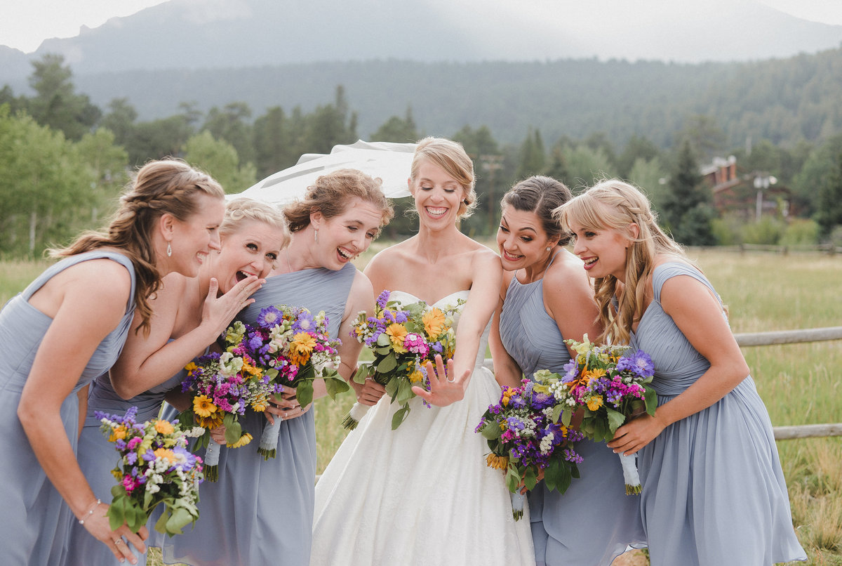 rocky mountain wedding photographer shot of bridesmaid looking at wedding ring