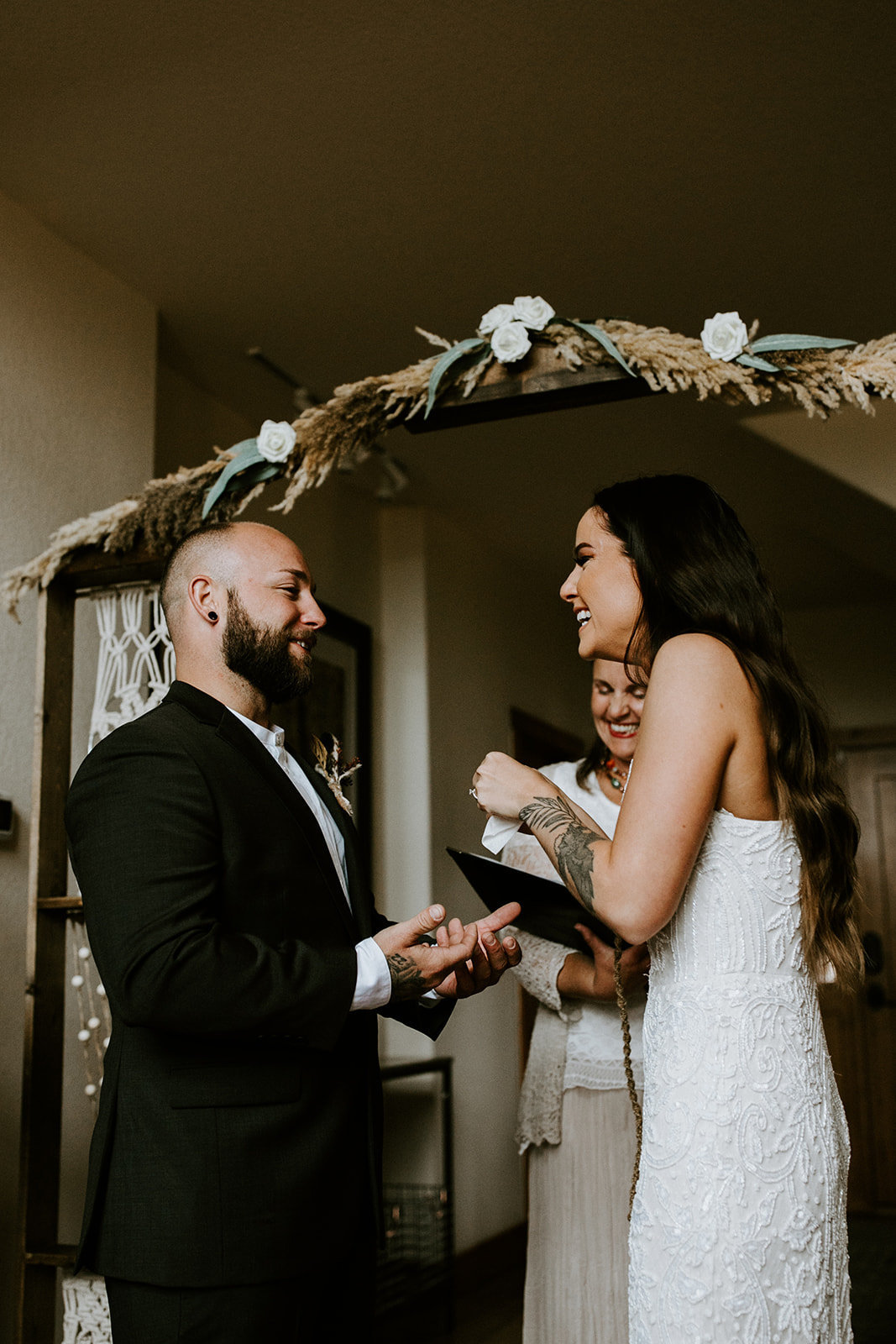 A bride and groom exchange vows.