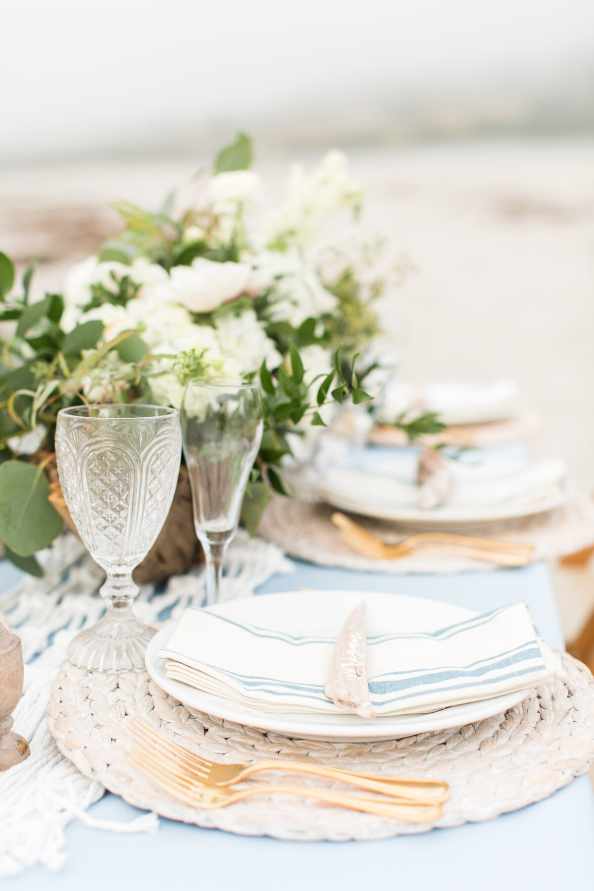 Maine coastal table scape with driftwood and greenery