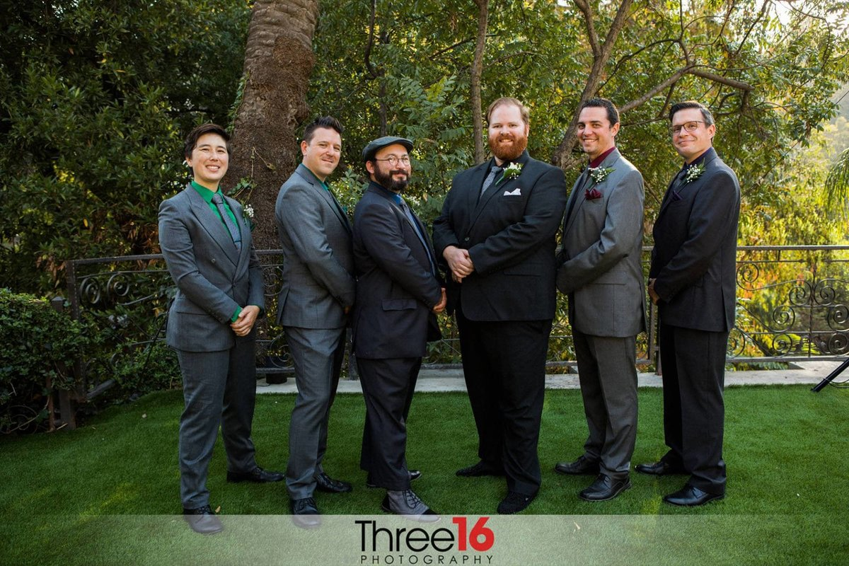 Groom and his Groomsmen pose for the photographer