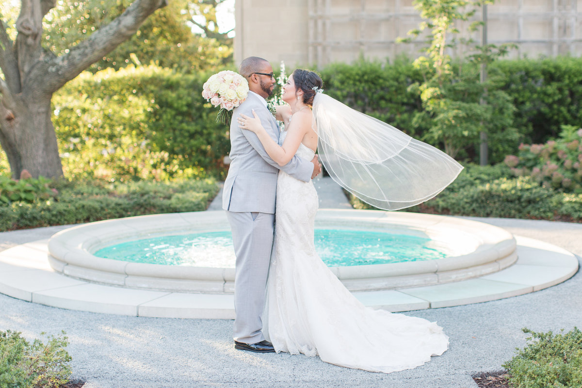 Bride's veil flowing in front of the fountain at Chrysler museum of Art