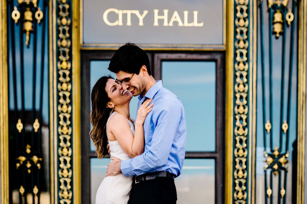 engagement photo at city hall in san francisco by stephane lemaire photography