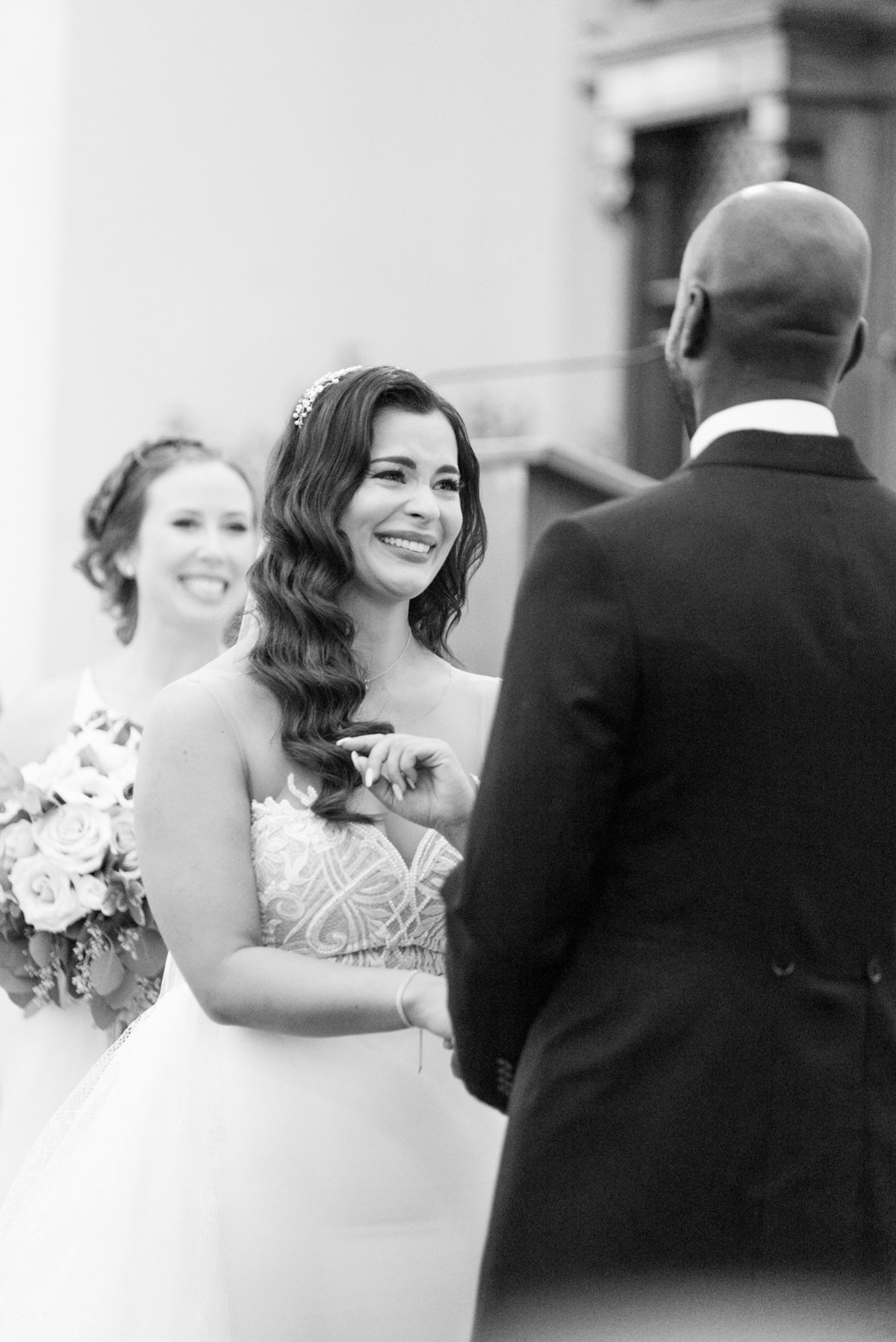 Bride looking at her groom during their vows at St. Andrew's Church in Thunder Bay