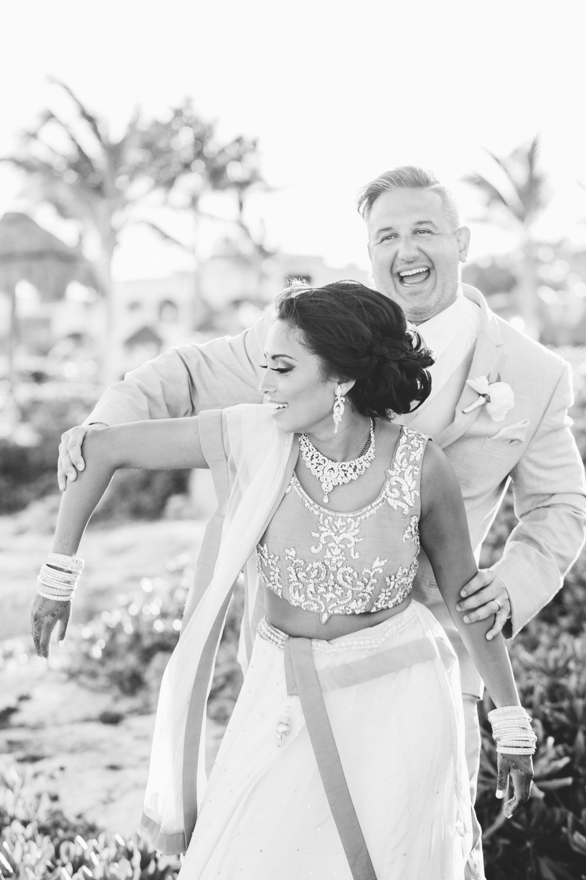 Who says you can't loosen up and just have fun?  Photo by destination wedding photographer Rebecca Cerasani.