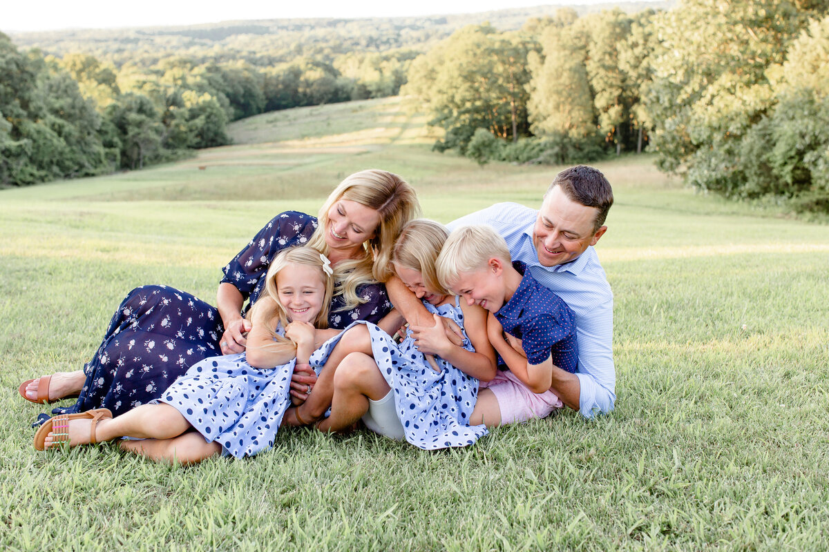 Summer Lifestyle Family  Session family of 5 playing  in field  in Southern Illinois by Amy Britton Photography Photographer  in St. Louis