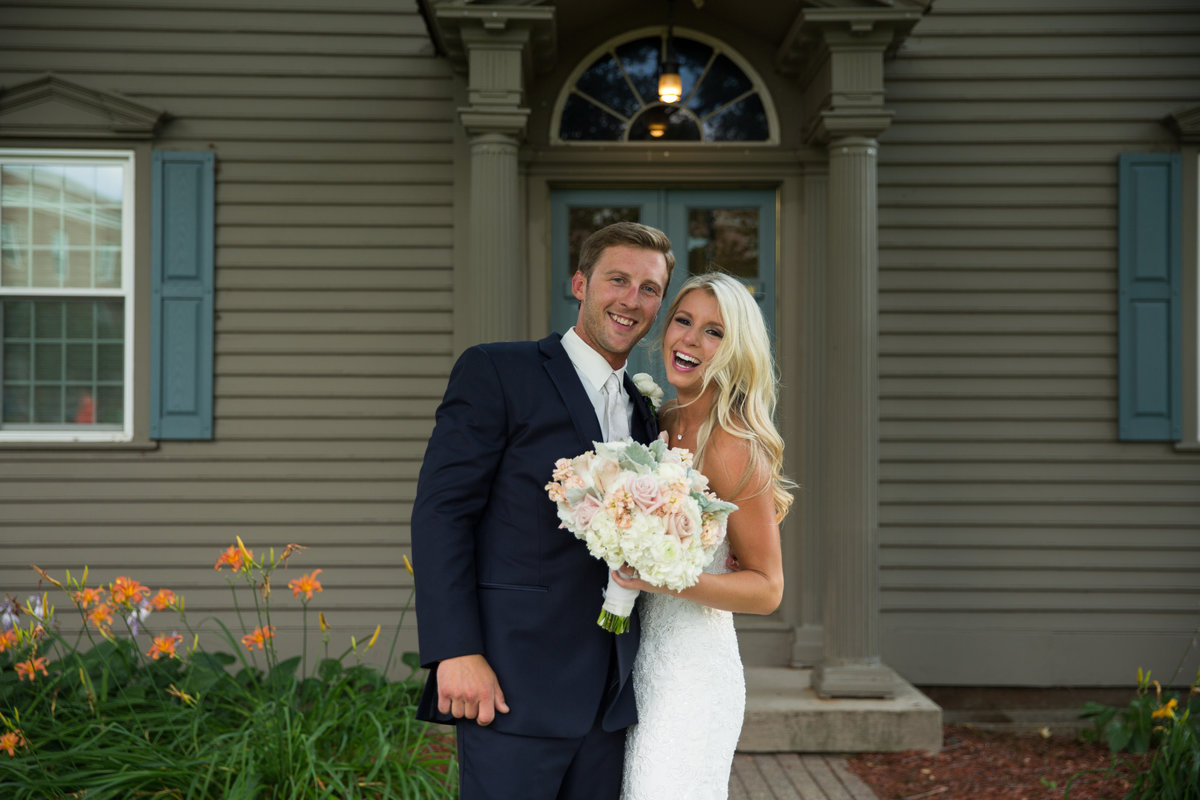 bride and groom excited to be just married at the Dearborn Inn, Dearborn, Michigan wedding  photographer Charlene Gurney
