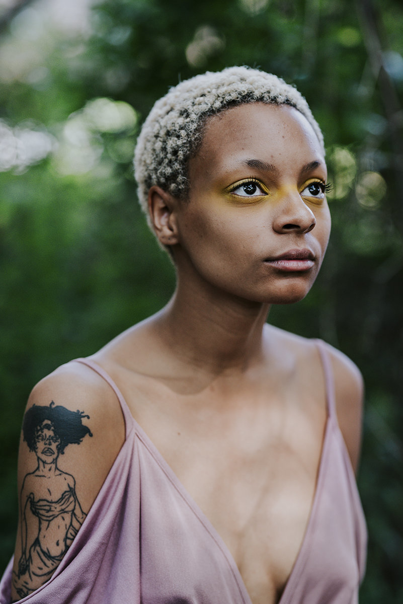 African American woman short hair and tattoo