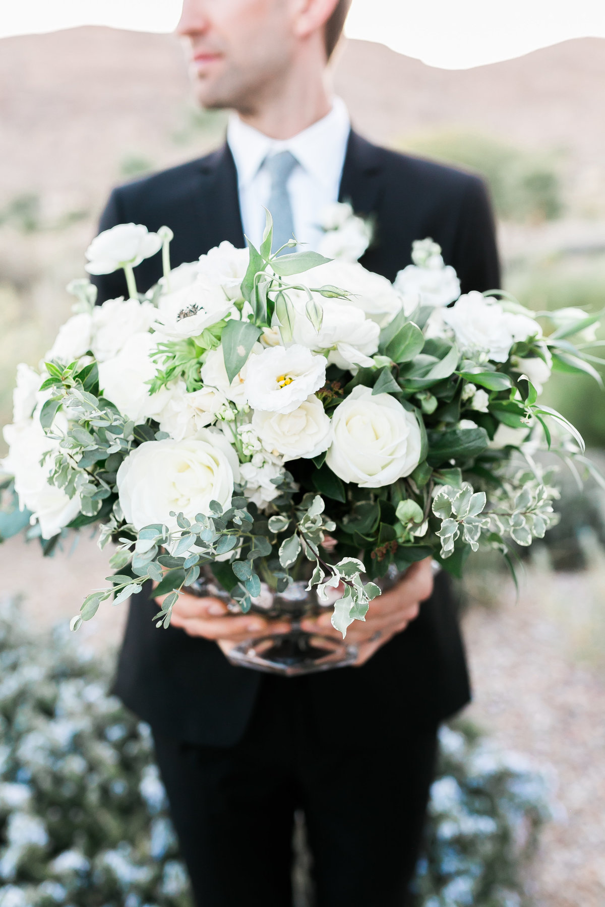 white floral bloom centerpiece with greenery