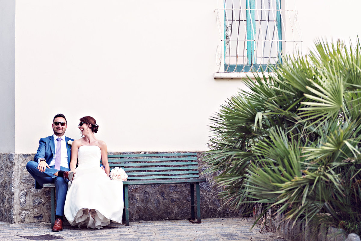 A bride and groom chilling in the streets of Ravello Italy