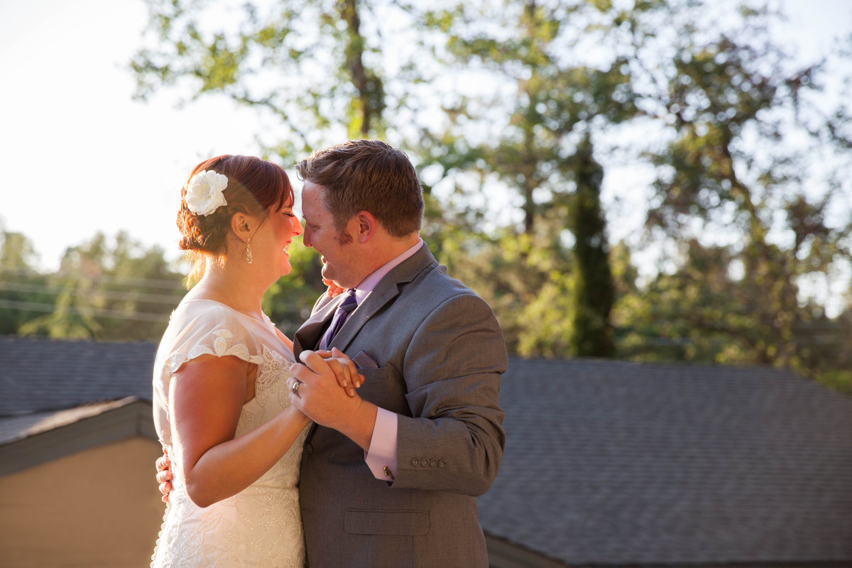 first dance in backyard wedding in golden hour light best for wedding photos halley lutz photography
