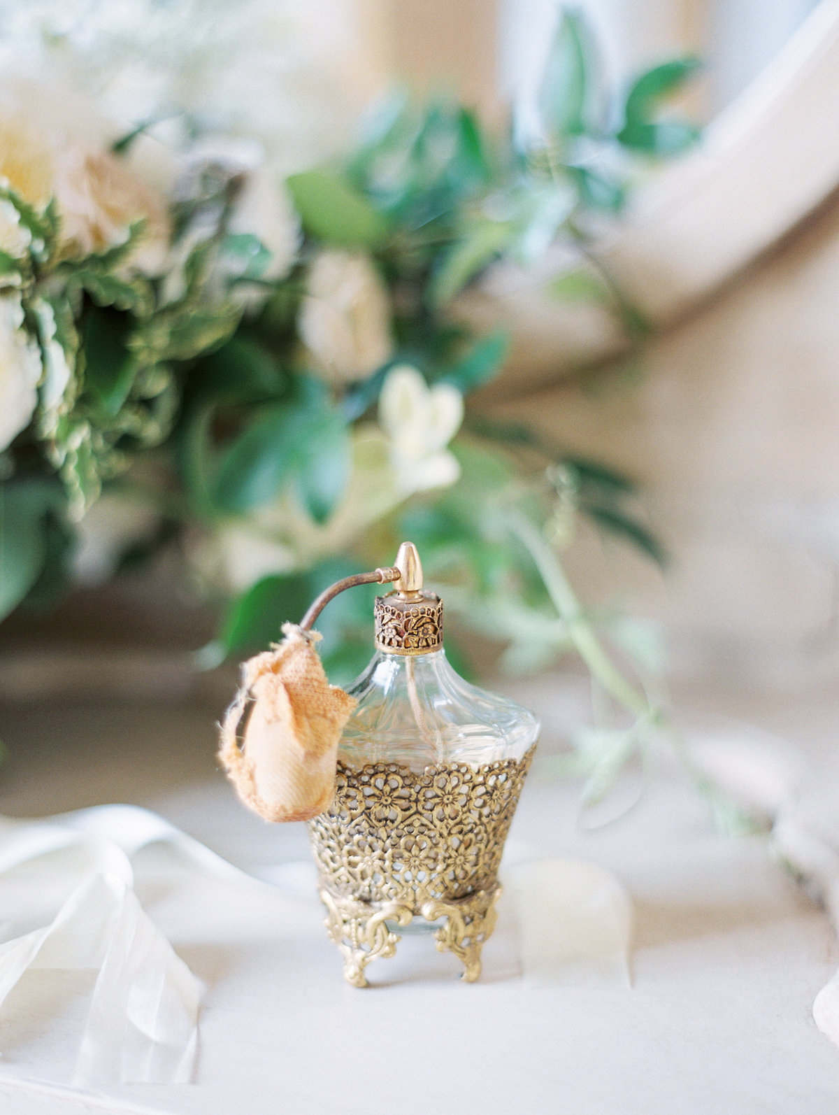 a bride's vintage perfume bottle