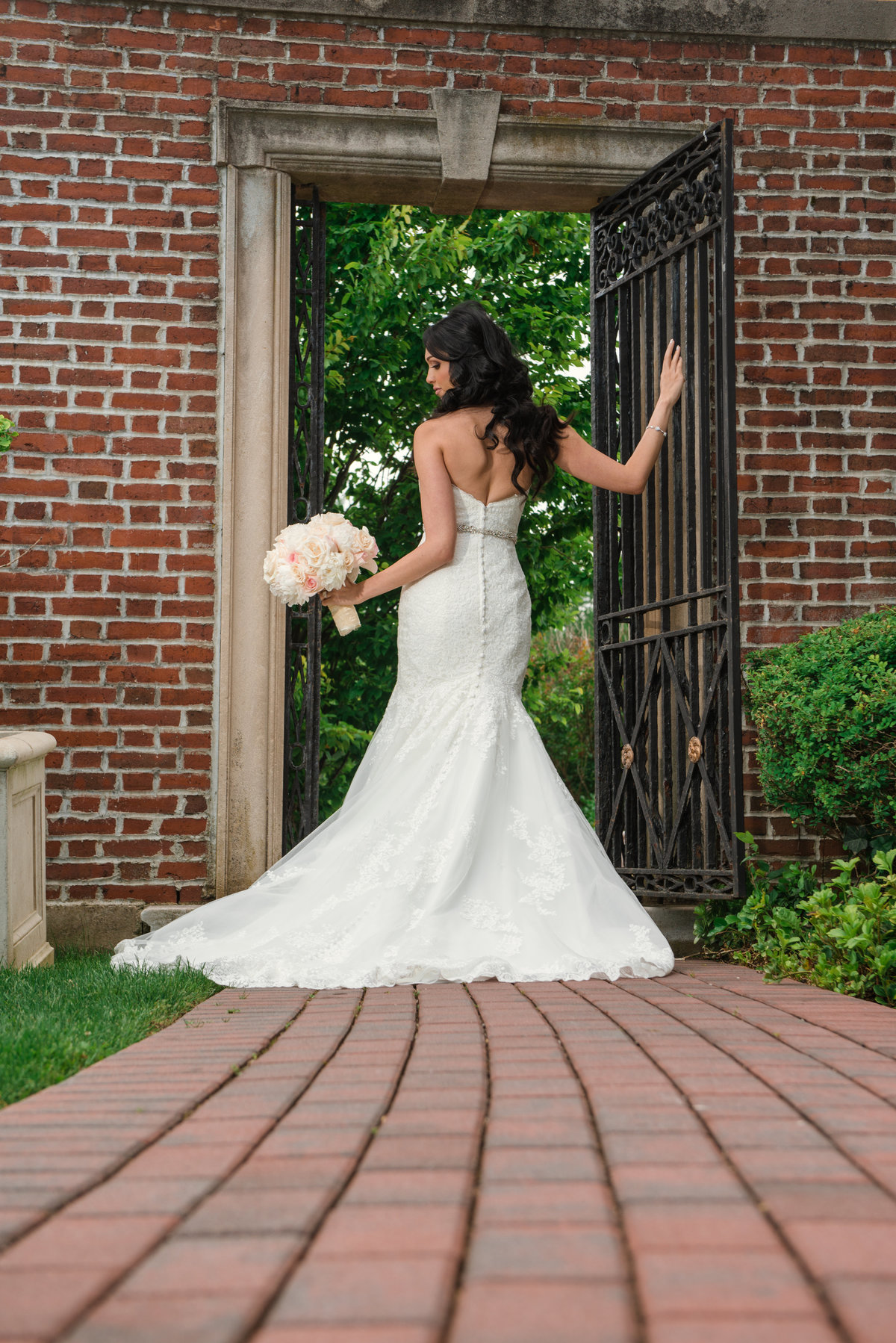 Bride at the gate at Glen Cove Mansion