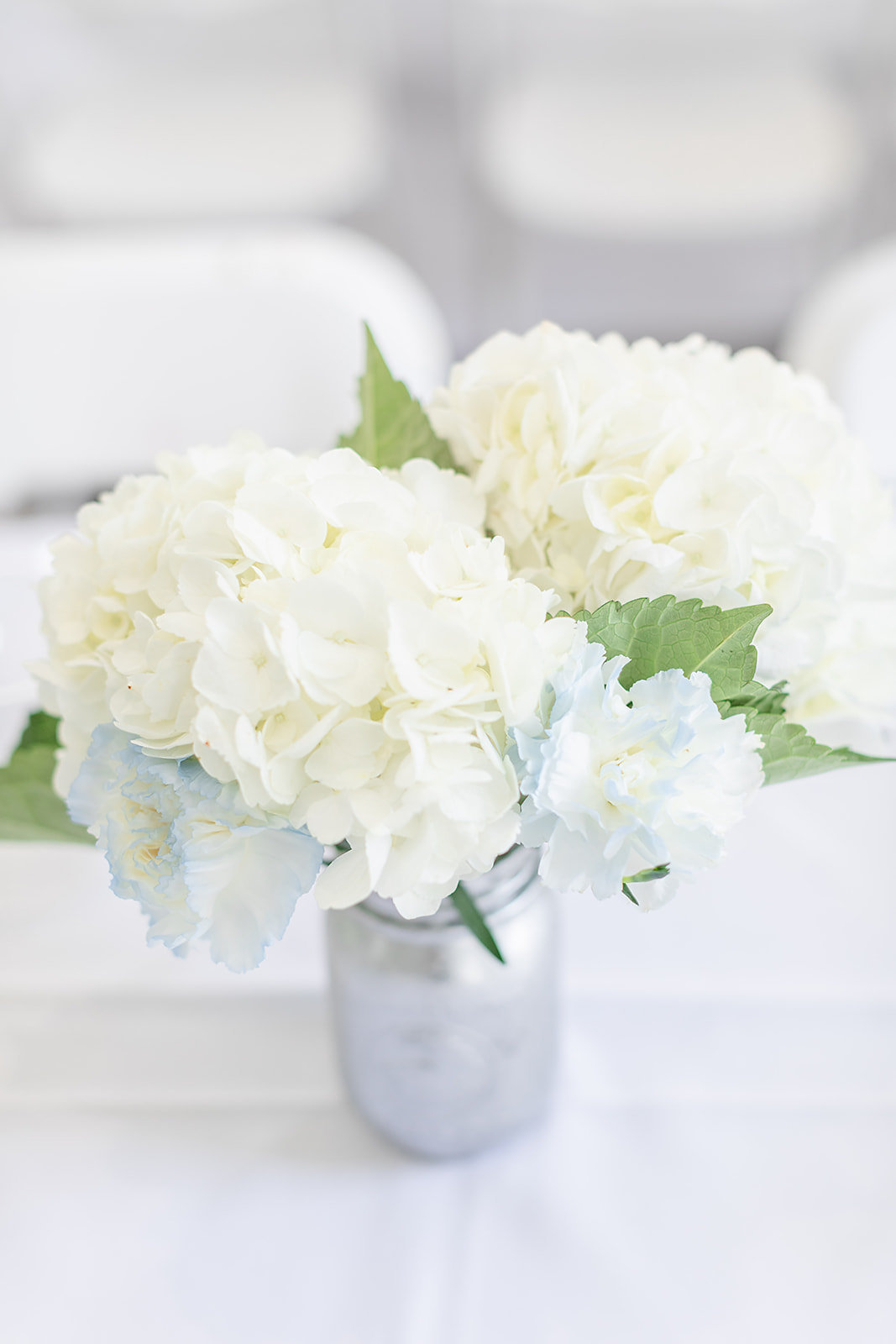 New Jersey bridal shower tablescape with mason jar and white and light blue floral arrangement