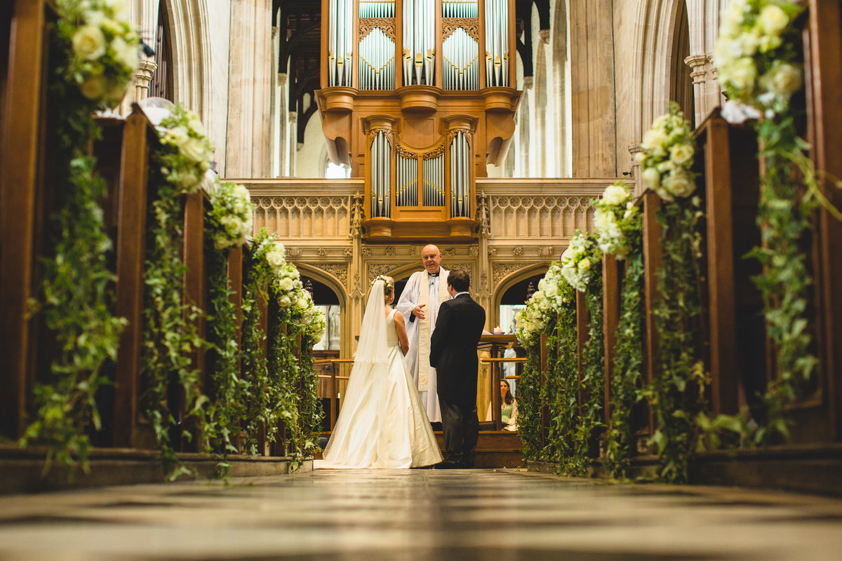 photograph from the back of the church in oxford down the aisle with flowers