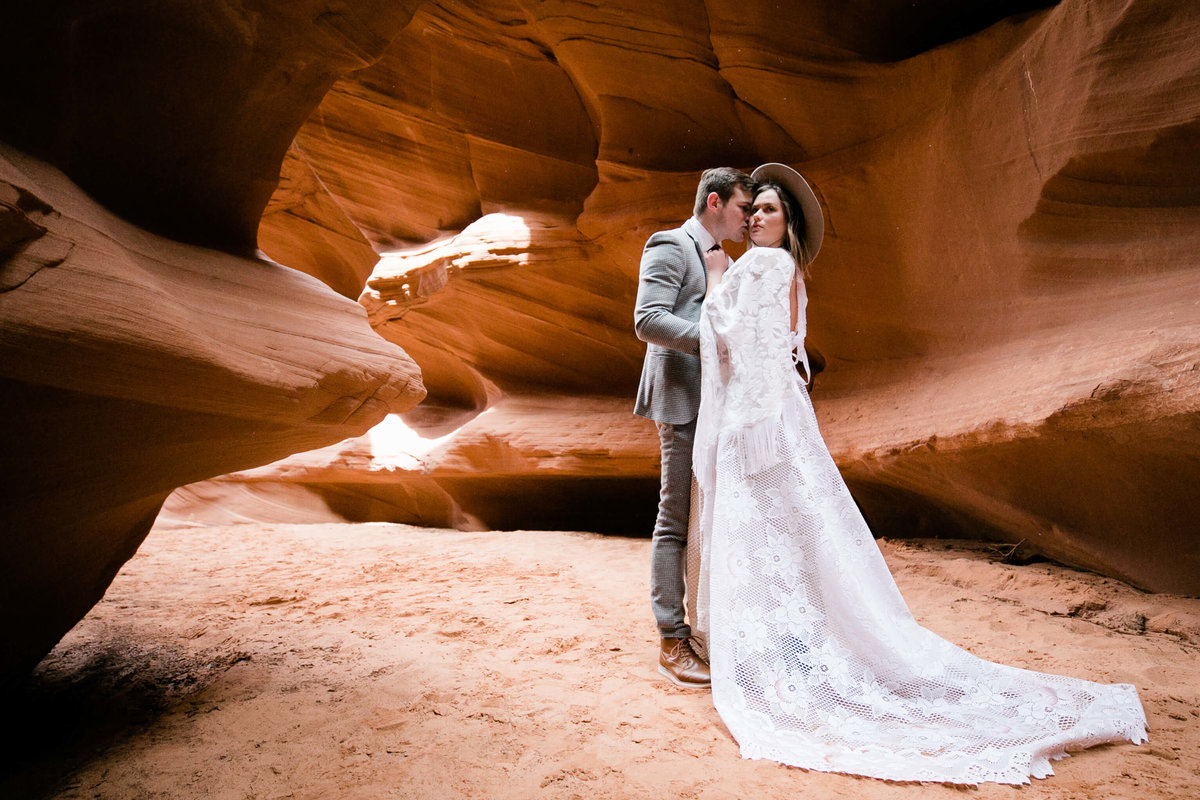 the couple poses for their portaits in the page arizona slotcanyon