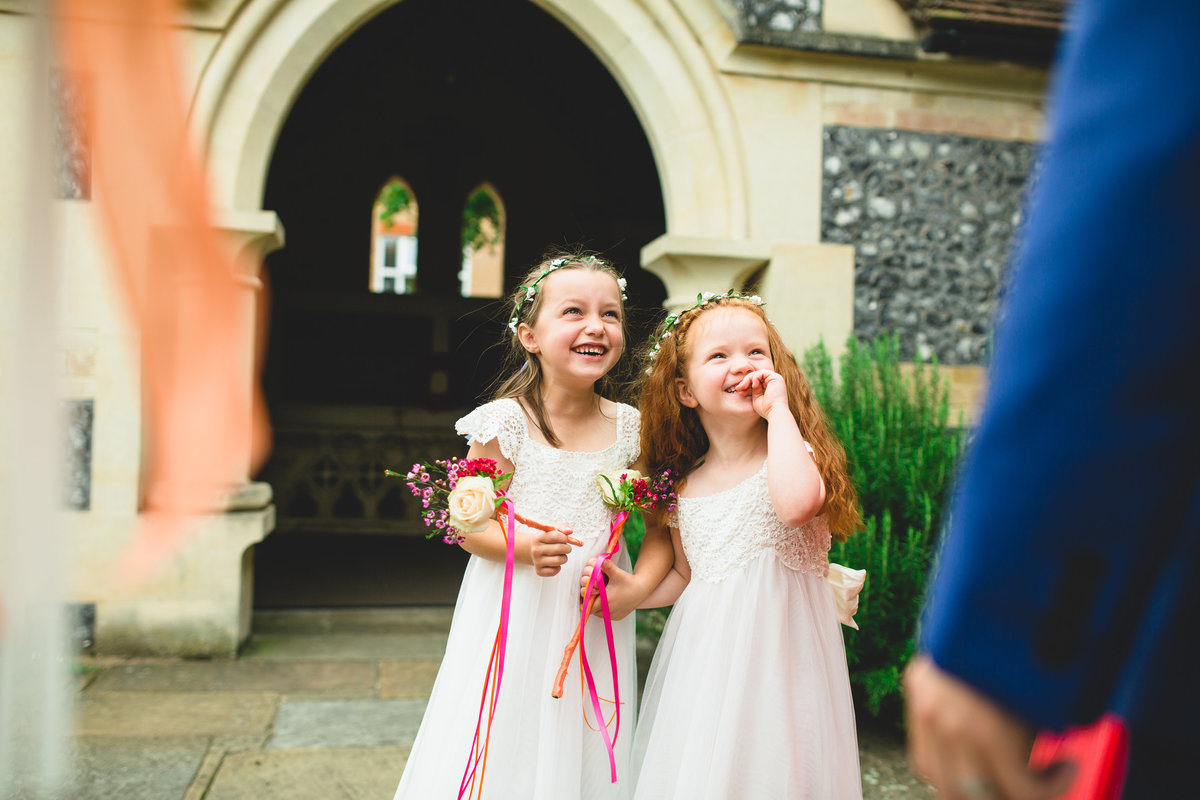 flower girls laughing after the wedding ceremony