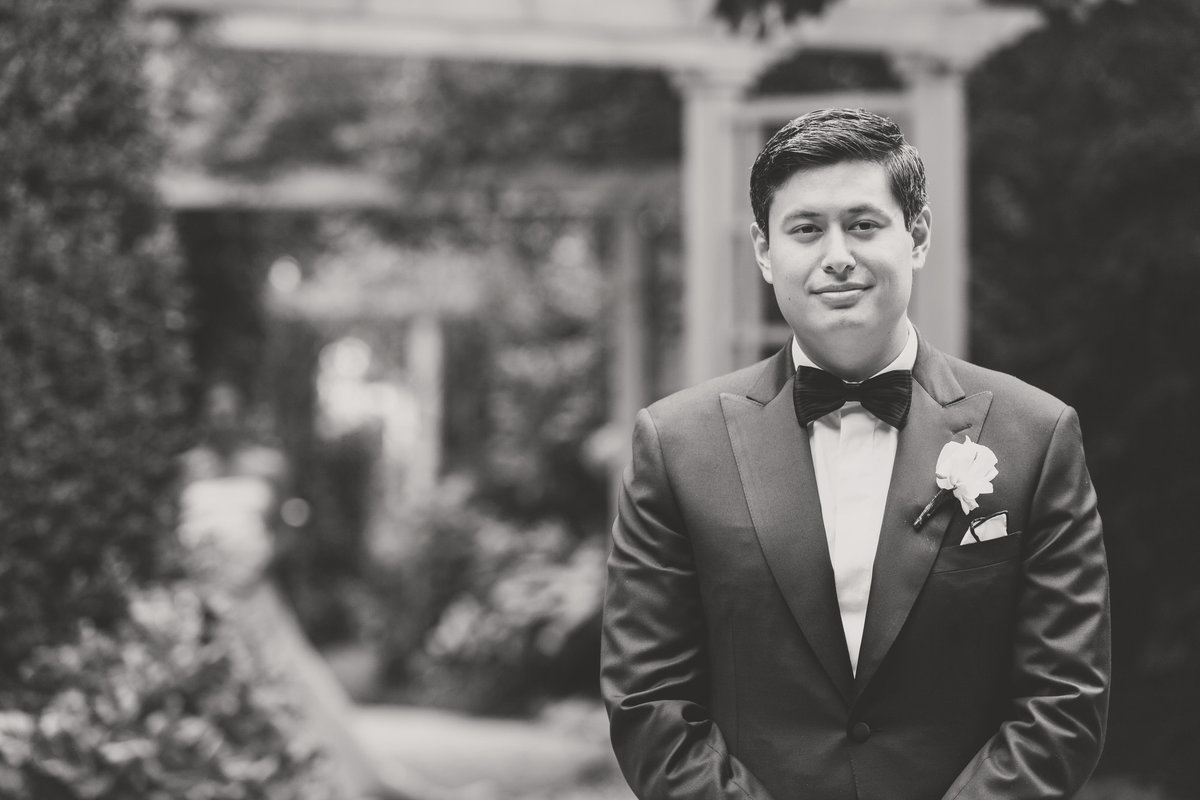 black and white solo shot of groom from wedding reception at The Garden City Hotel
