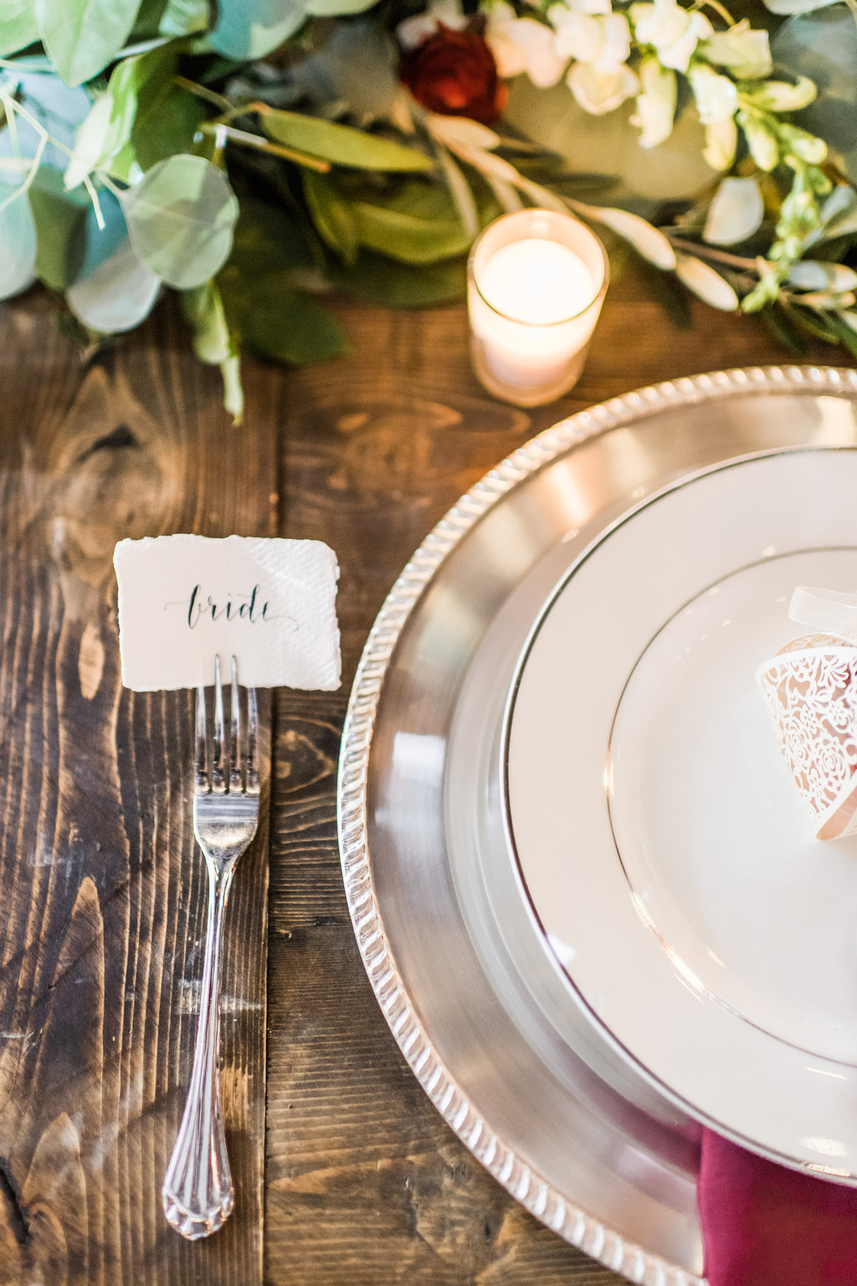 Ripped edge paper with personalized name cards on a farmhouse table at Great Marsh Estate in Virginia.