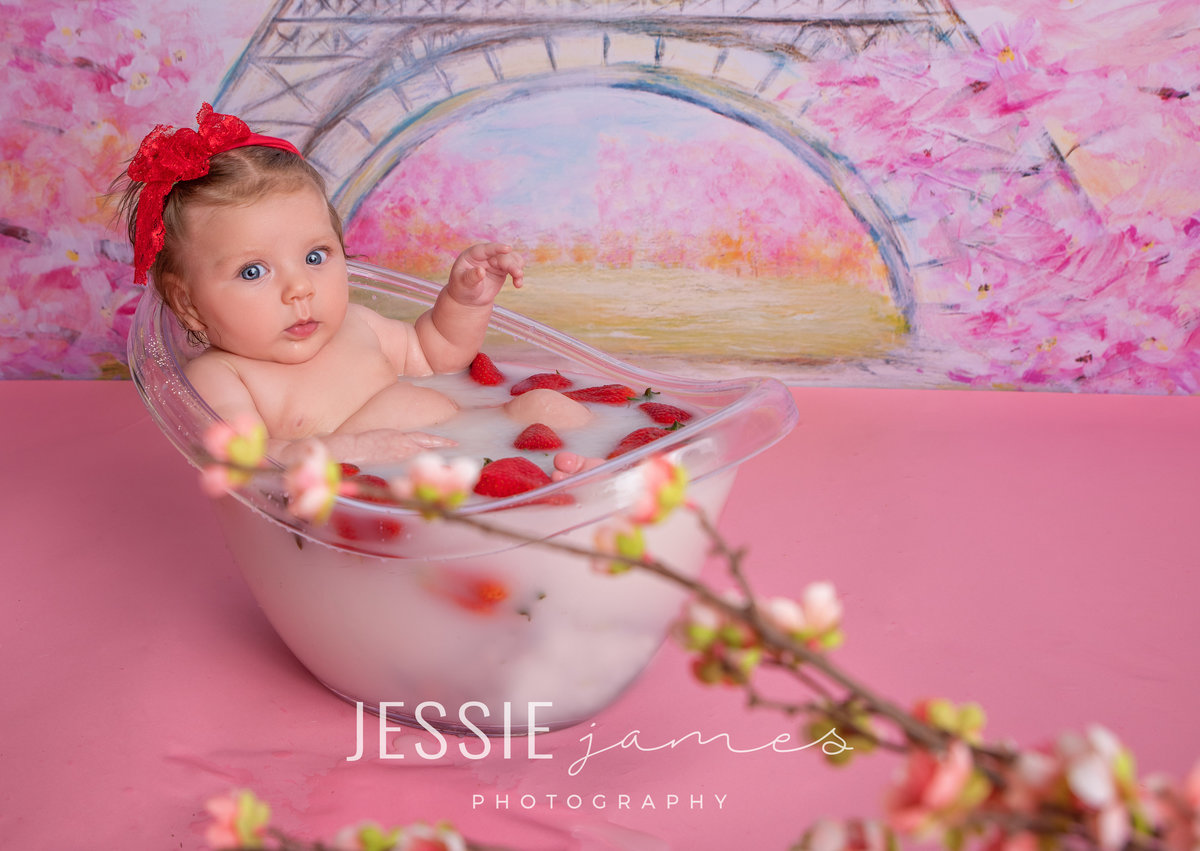 baby girl in a milk bath with fruit, milk bath photosession