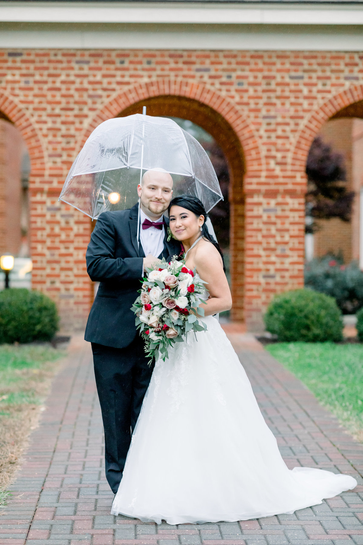 Washington DC Wedding Photography, bride and groom under an umbrella