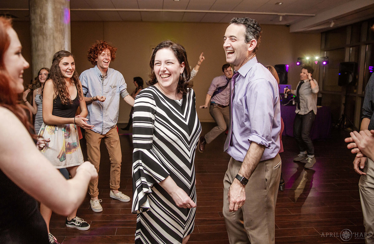 Parents dance together at a bat mitzvah party in Denver Colorado