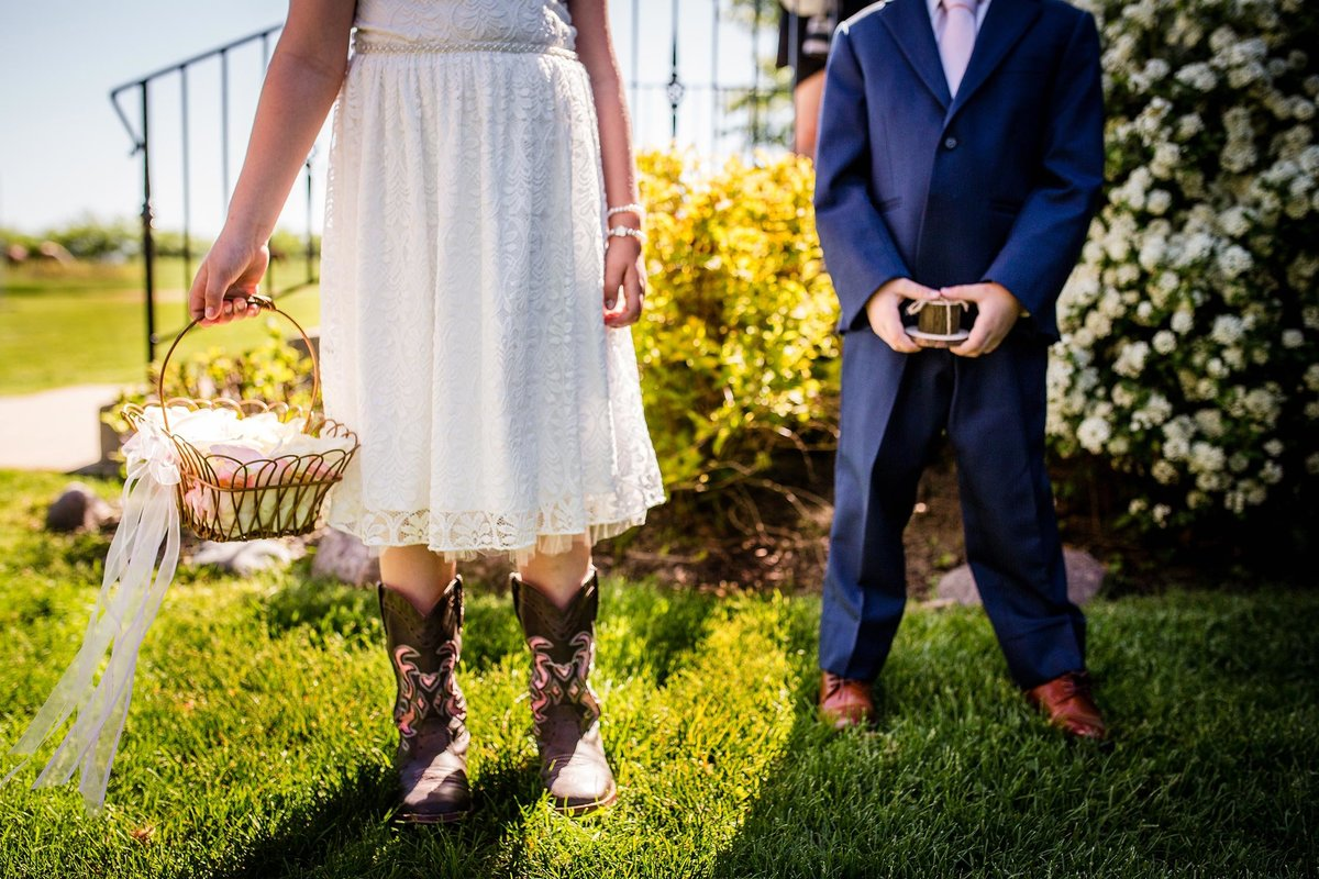 A flower girl and ring bearer wait for the ceremony at an Oak Hill Farm wedding.