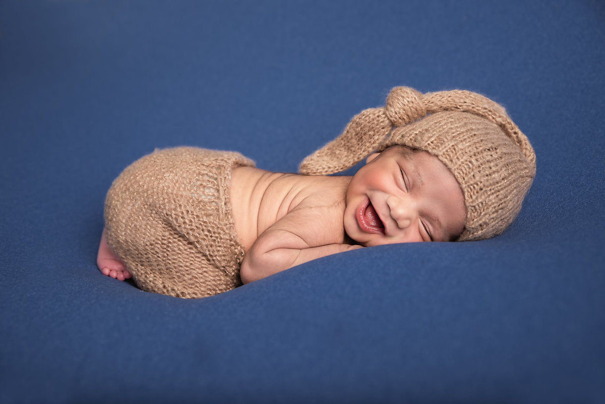 newborn baby boy smiling