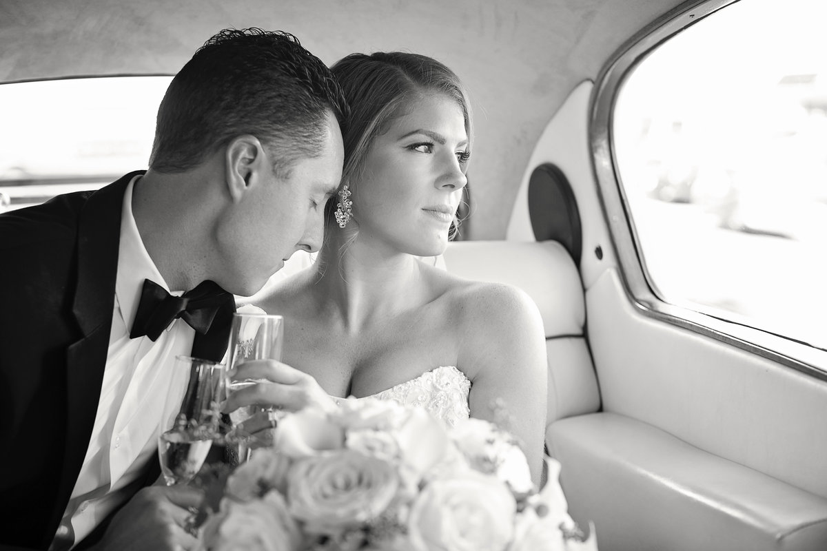 brie and groom in rolls royce after wedidng