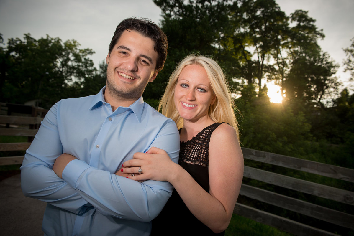 Linked armed engagement couple at sunset along the DuPage River