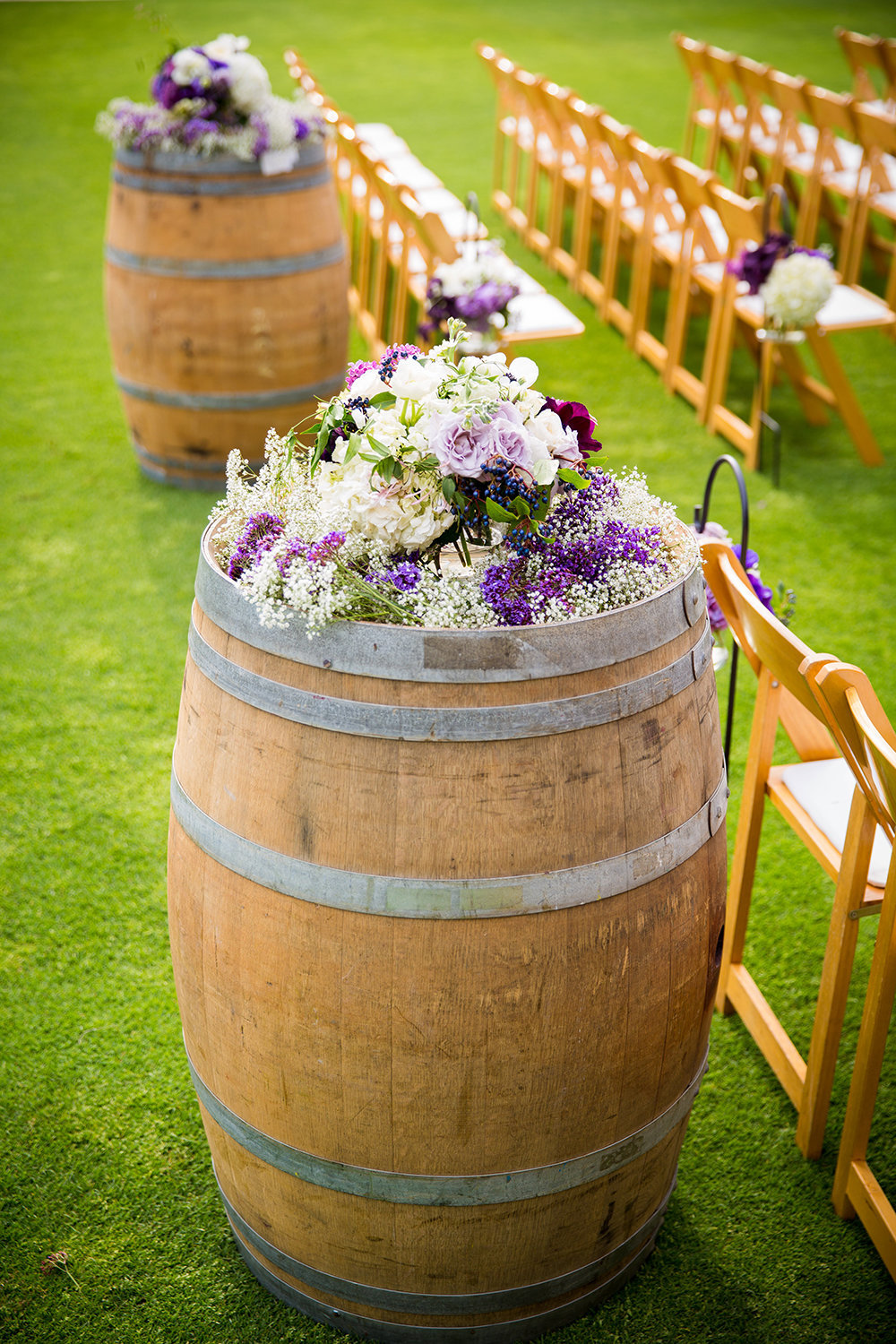 Sycuan wedding photos wine barrels with flowers rustic