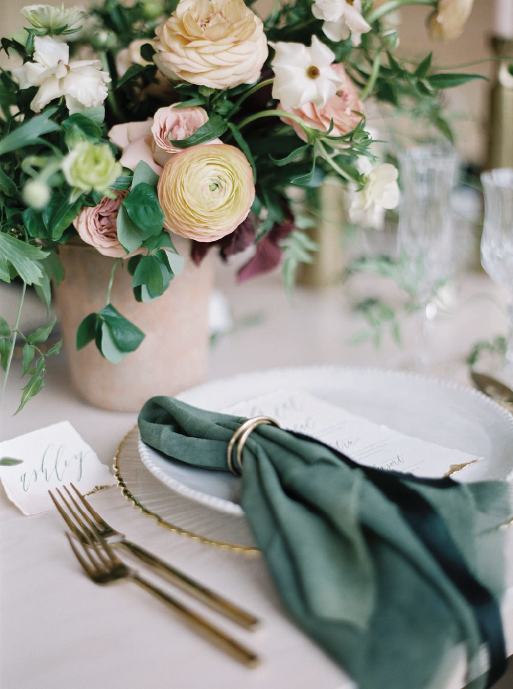 plant dyed napkins, gold flatware, custom calligraphy