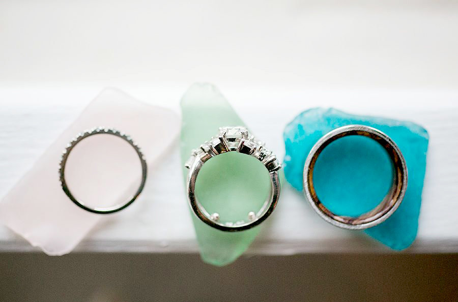 wedding rings on sea glass