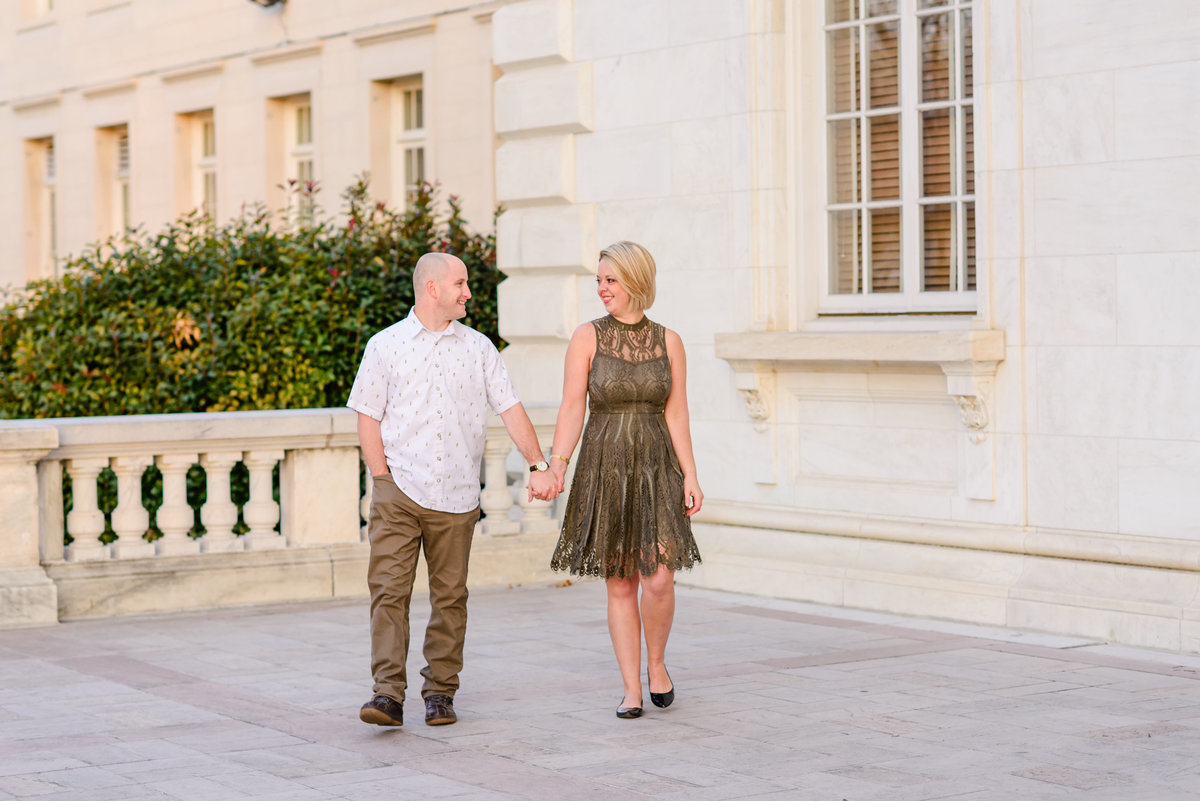 Sunrise engagement session in washington DC with white columns and architecture
