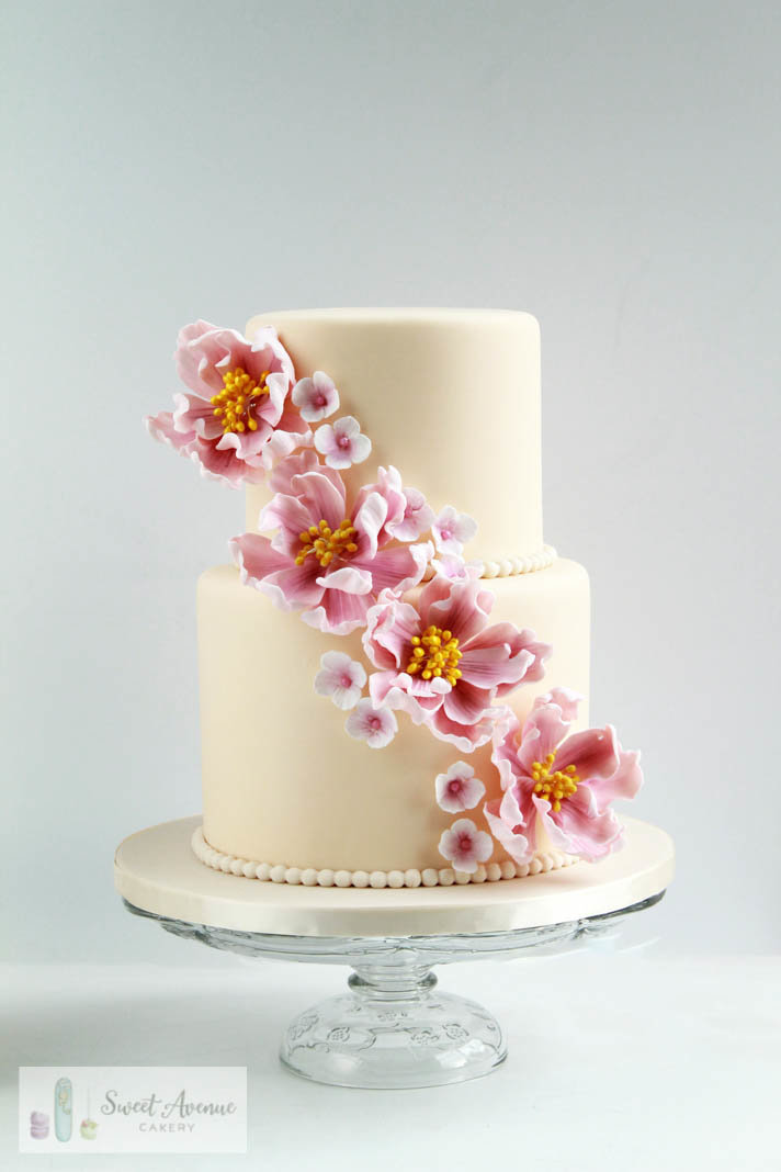 ivory wedding cake with cascade of sugar peonies