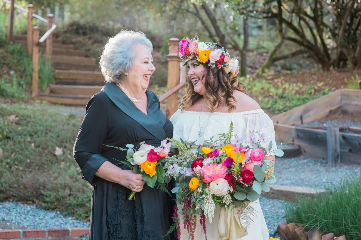 Mother of the bride and bride laughing together Bride and groom joining cocktail hour at Madrona Manor in Healdsburg California.jpg