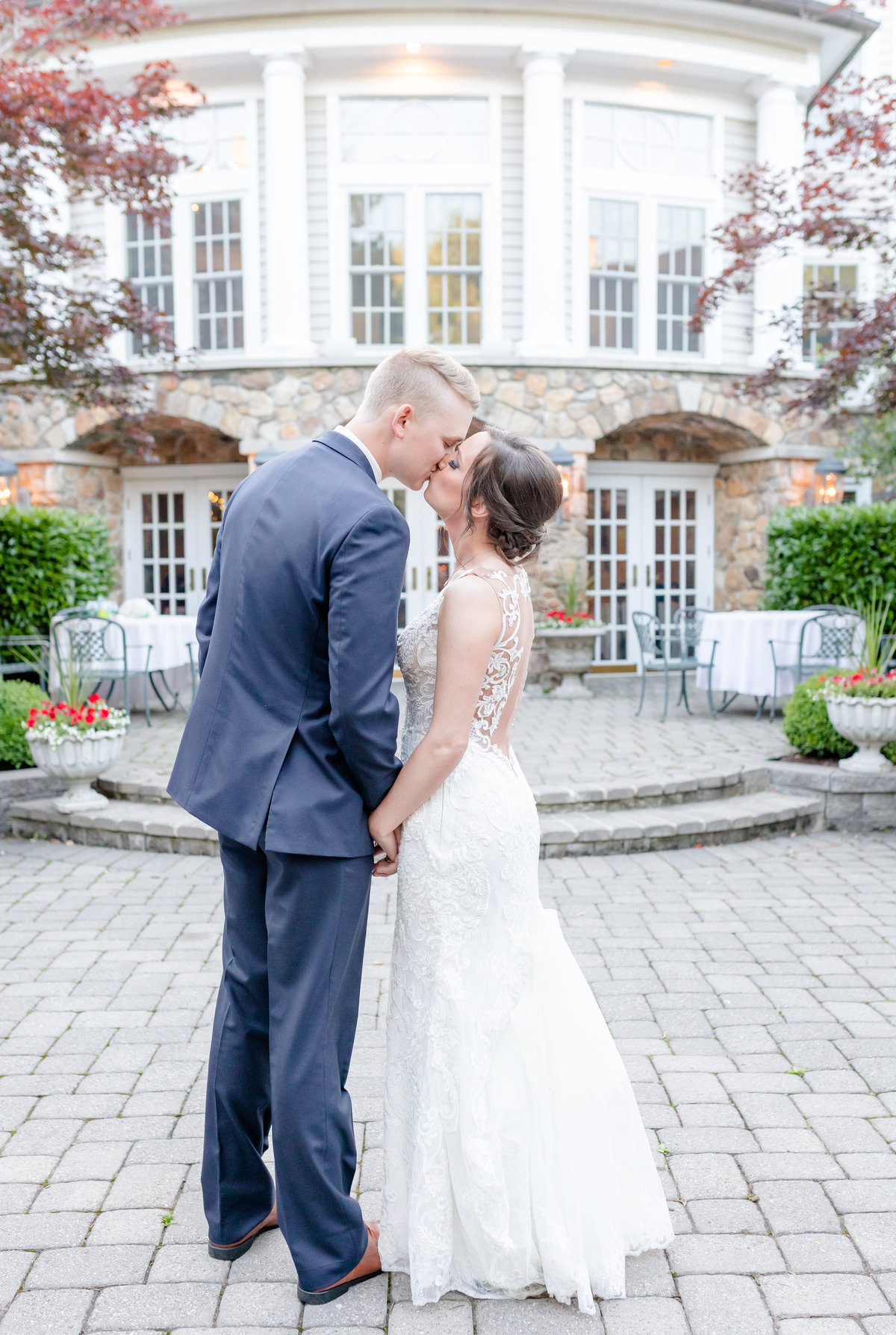 Olde Mill Inn wedding with bride and groom kissing outside