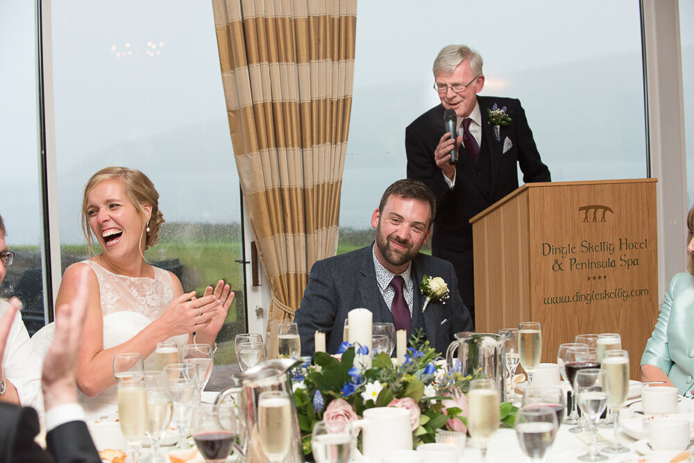 bride and groom laughing out loud during the father of the groom speech in the Dingle Skellig Hotel