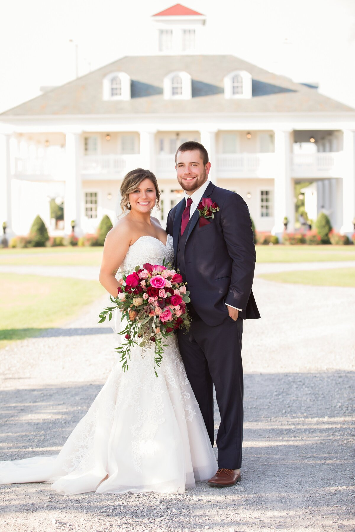 bride and groom in front of plantation house