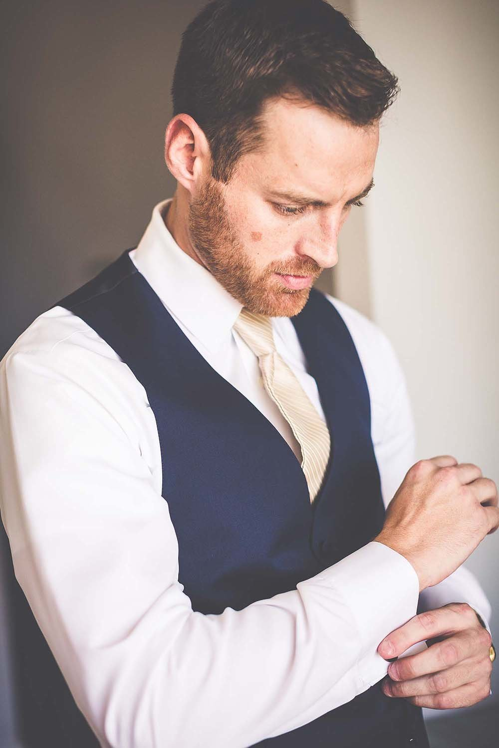 groom-getting-ready-photo-inspiration-breaking-tradition-castle-gate-wedding-otttis-st-augustine