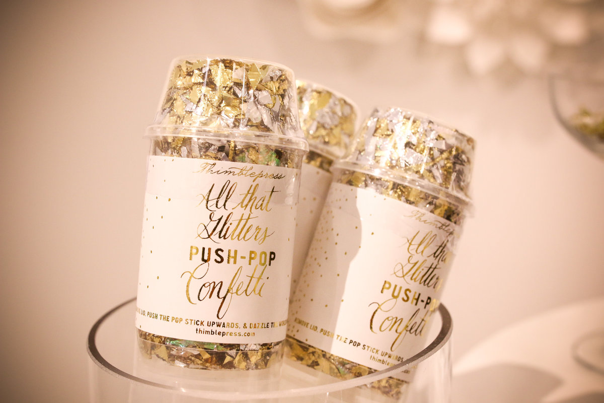 Branding photography for Sugarfina with confetti poppers