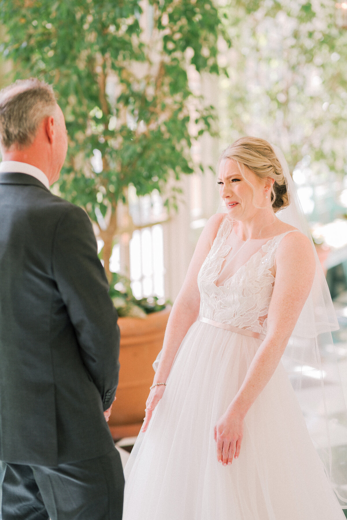 Bride cries as she has her first look with her father on her wedding day
